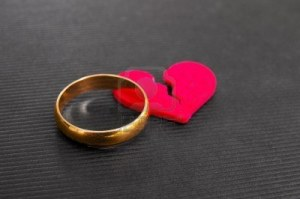 14033933-gold-wedding-ring-and-red-broken-heart--divorce-concept
